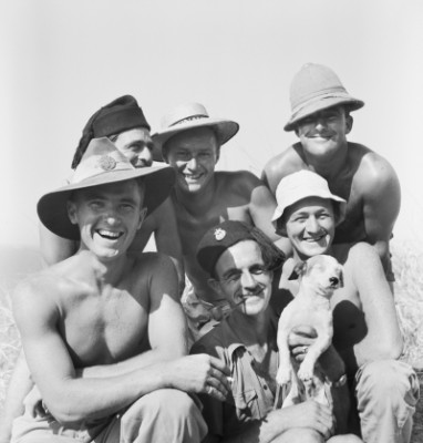 A group portrait of Australians with their mascot, a dog named Spaghetti.