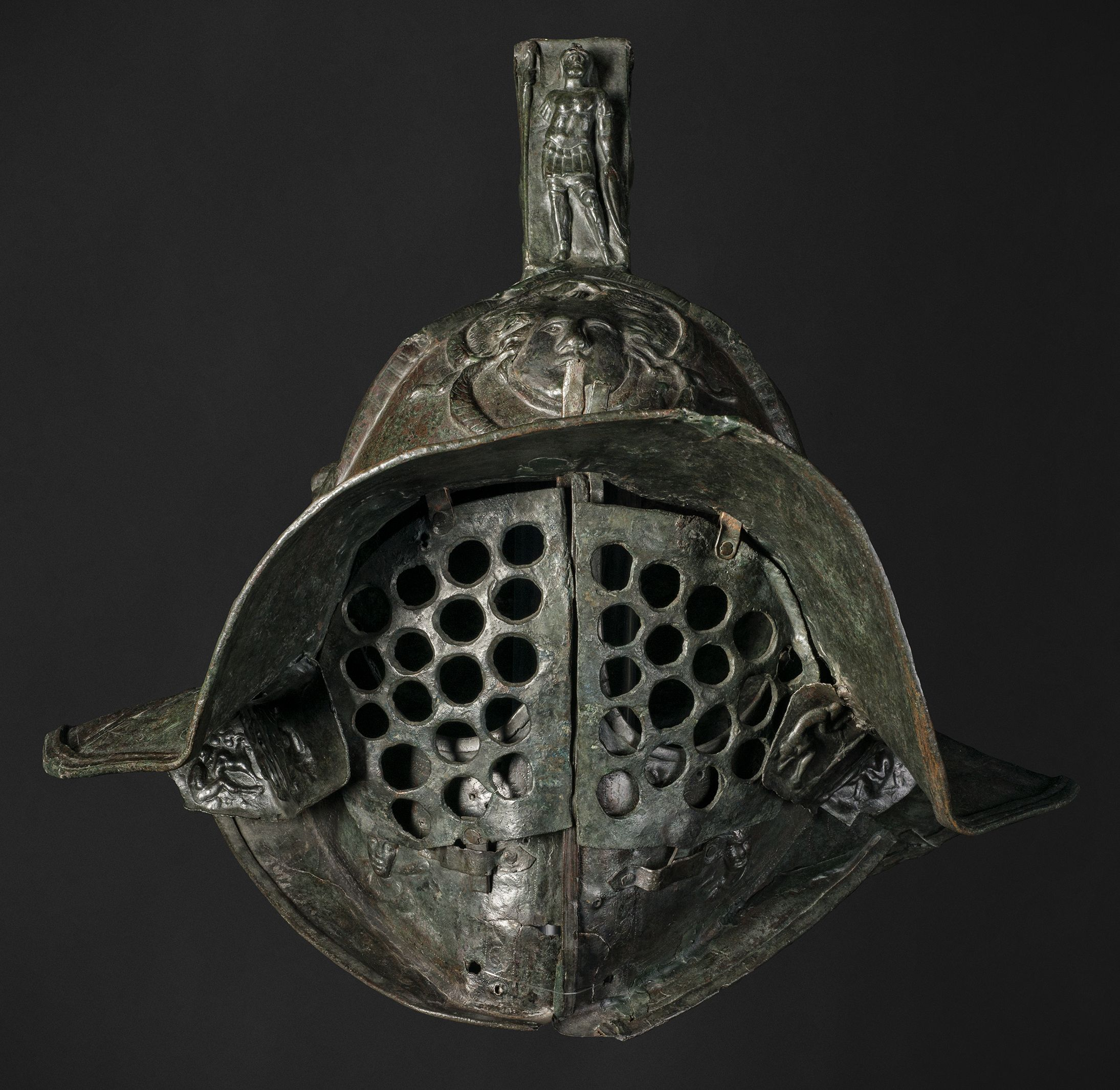 Helmet of a Murmillo, from the Barracks of the Gladiators of Pompeii, Bronze, AD 1 © Museo Archeologico Nazionale, Naples