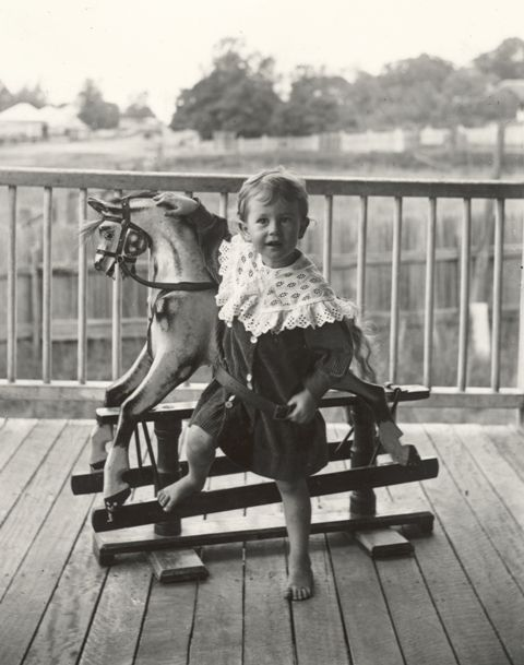 A Queensland child with his rocking horse, early 1900s.