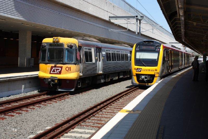 The first electric suburban Set 01 stands at Roma Street station next to the newest Set 278 in November 2009.